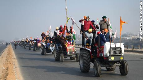 Farmers take part in a tractor rally as they continue to demonstrate against the central government's recent agricultural reforms in New Delhi on January 26, 2021.