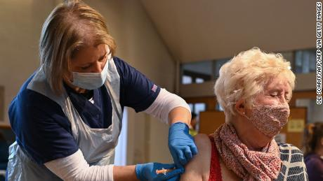 A woman from the top four priority groups receives the Oxford/AstraZeneca vaccine at a church in Yorkshire, northern England on January 23.