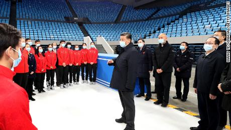 Chinese President Xi Jinping talks with athletes and coaches of China's national figure skating and short track speed skating teams while visiting the Capital Gymnasium in Haidian District, Beijing, on January 18.