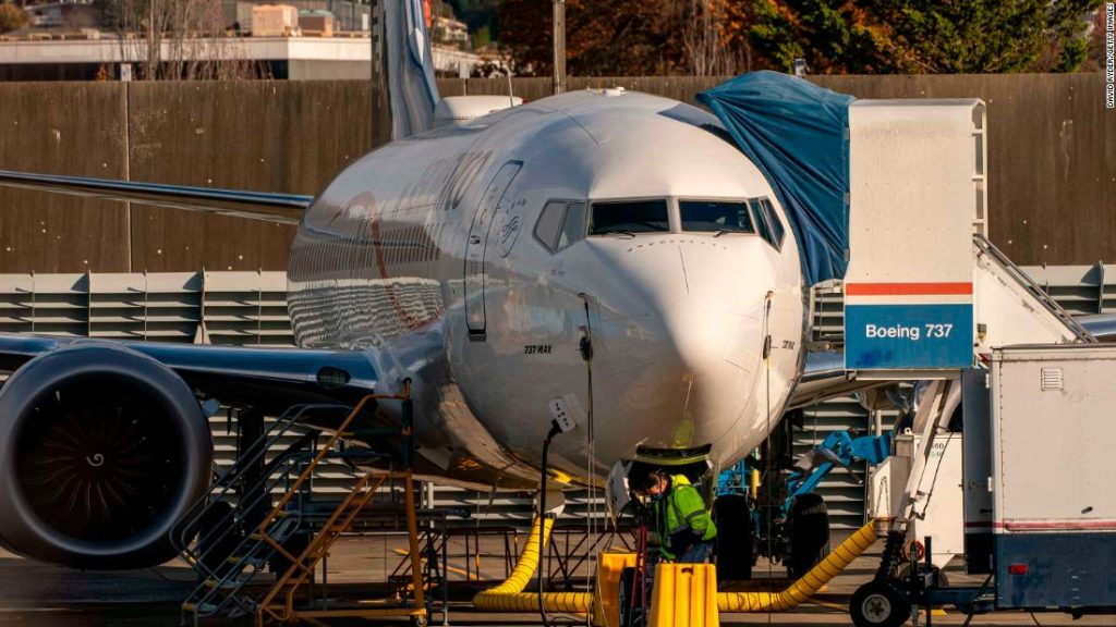 Boeing posts a record loss on combined crises