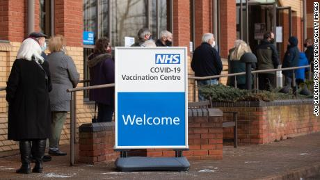 People line up outside a Covid-19 vaccination center in Stevenage, in central England, on January 11.