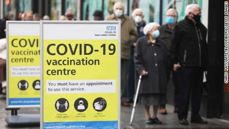 People queue before receiving the Oxford/AstraZeneca vaccine in Folkestone, southern England on January 27.