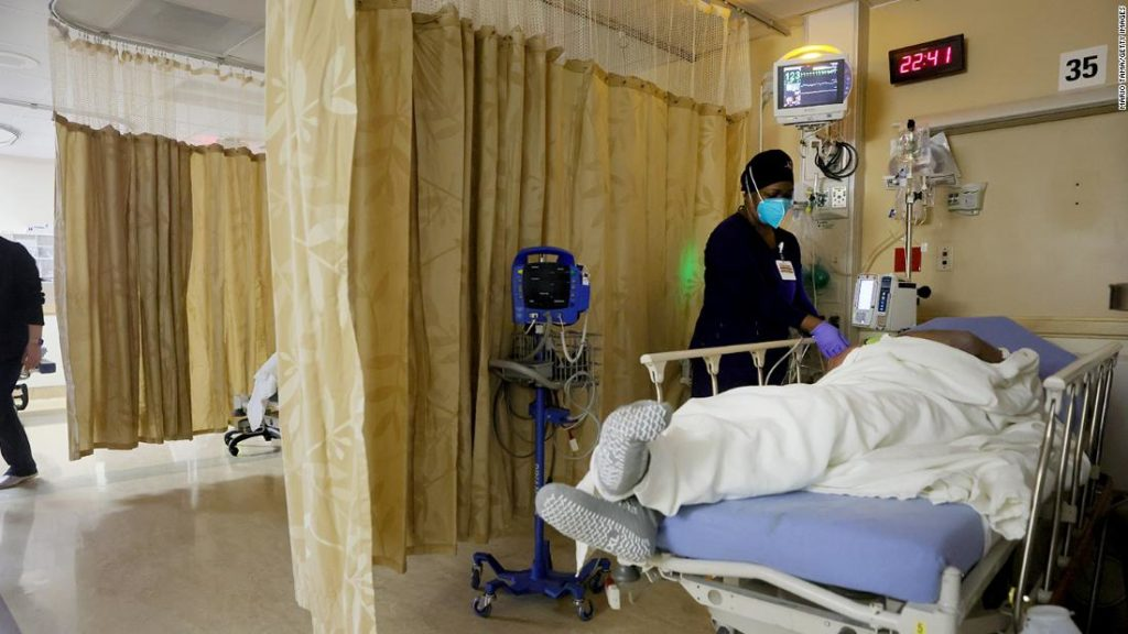US Coronavirus: Hospitalizations are the lowest they've been in nearly 2 months. But US is still in for 'rough' coming weeks, expert says