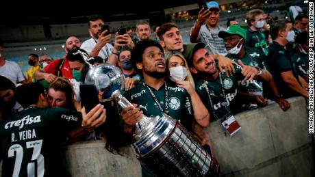 Palmeiras players celebrate with the limited number of fans allowed into the stadium.