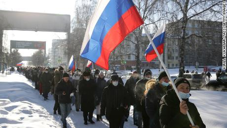Demonstrators take part in an unauthorised protest Sunday in support of Navalny in central Novosibirsk.