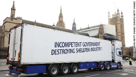 A truck drives past the Houses of Parliament in a protest against post-Brexit red tape.