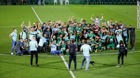 Chapecoense players celebrate their promotion to Serie A.