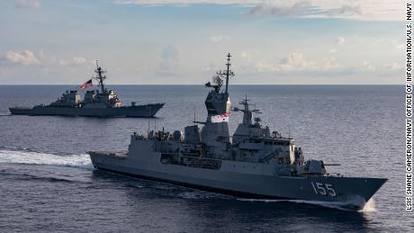 The US guided-missile destroyer USS John S. McCain, rear, and the Royal Australian Navy HMAS Ballarat sail together during integrated operations in the South China Sea in October.