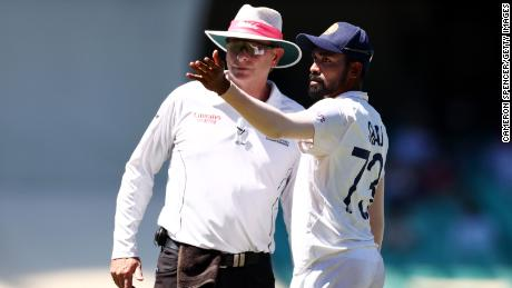Mohammed Siraj of India stops play to make a formal complaint to umpire Paul Reiffel about some spectators in the bay behind his fielding position during day four of the third Test match in the series between Australia and India at Sydney Cricket Ground on January 10, 2021.
