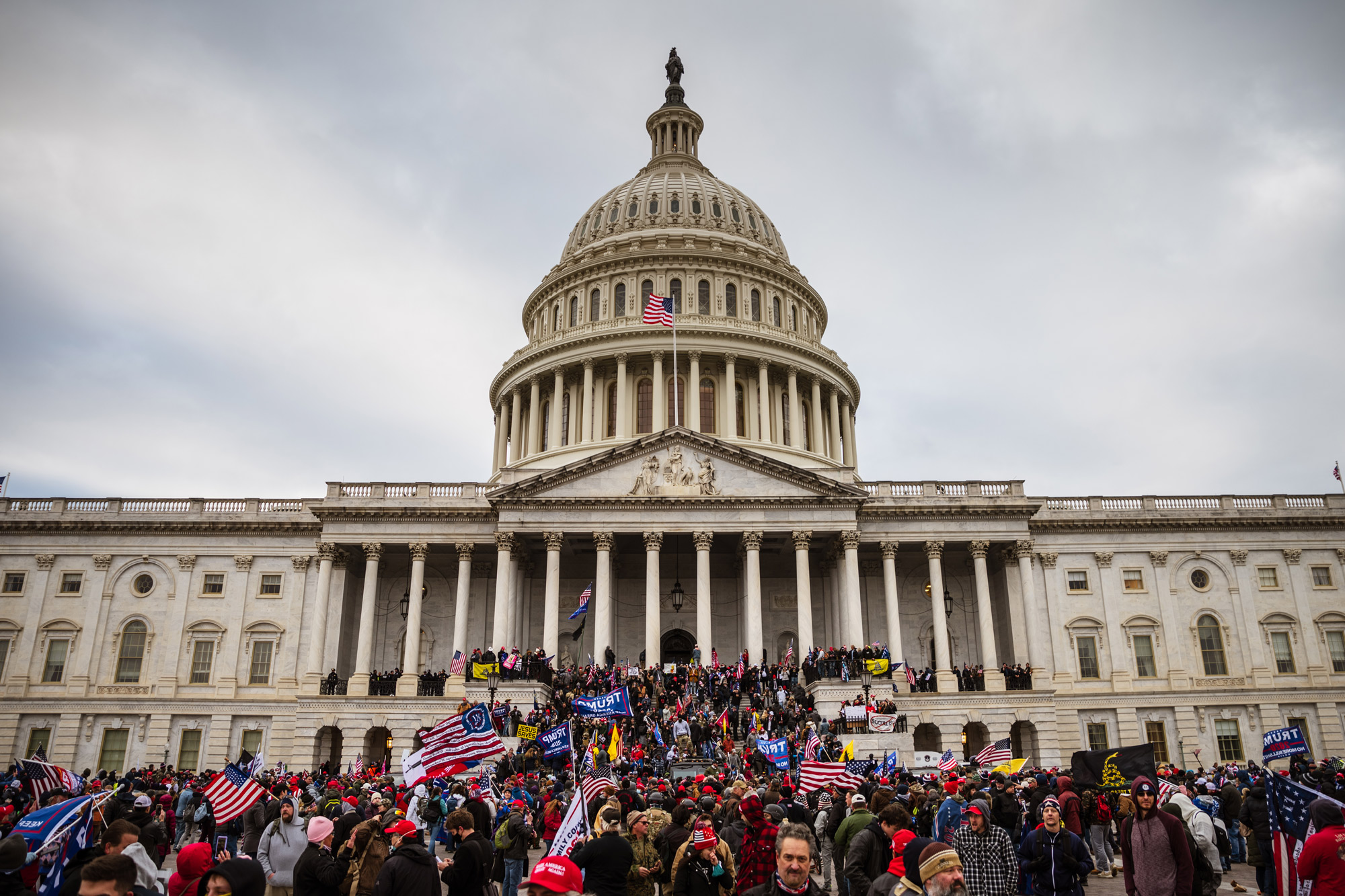 A large group of pro-Trump protesters stand on the East steps of the Capitol Building after storming its grounds on January 6 in Washington, DC.