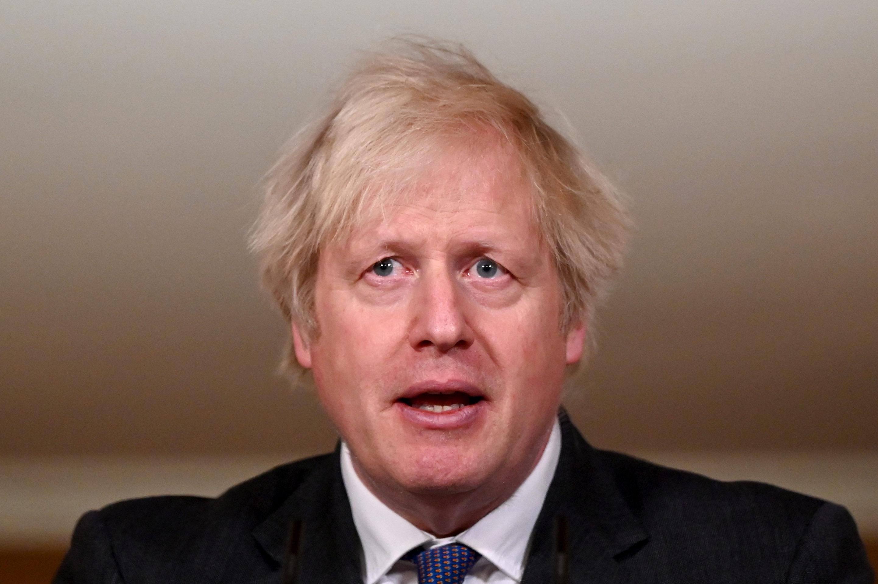 UK Prime Minister Boris Johnson speaks during a coronavirus press conference at 10 Downing Street on January 22, in London.