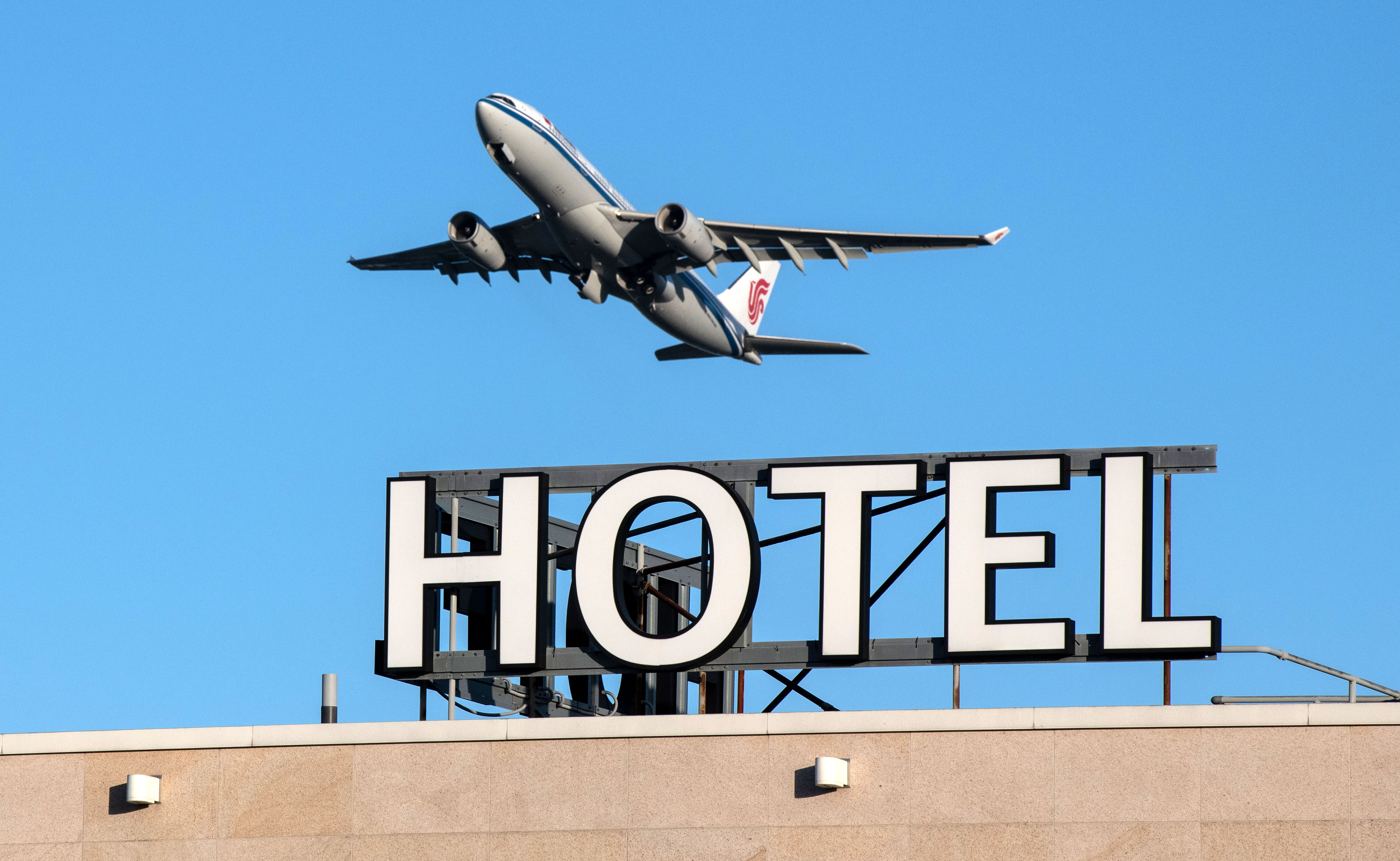 An airplane passes over a hotel as it takes off from Heathrow Airport in London on January 25.