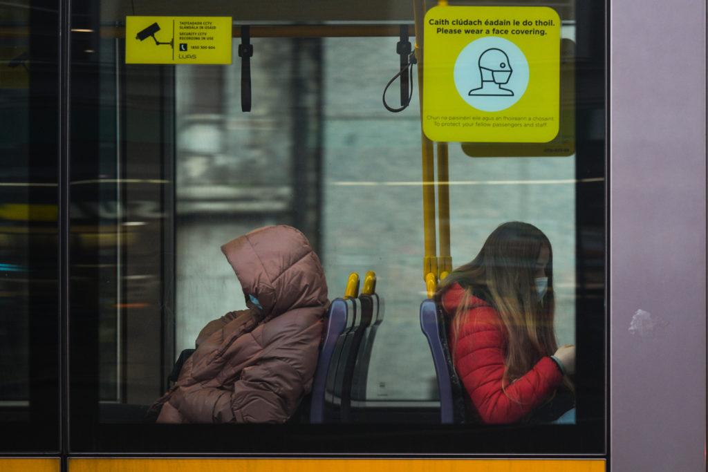 People wearing face masks are seen inside a tram in Dublin, Ireland on January 6.