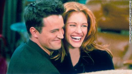"""Matthew Perry and Julia Roberts hug on the set of """"Friends."""""""