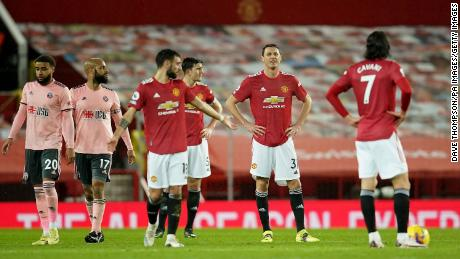 Manchester United's Nemanja Matic (centre) and team-mates appear dejected after they concede a second goal against Sheffield United.
