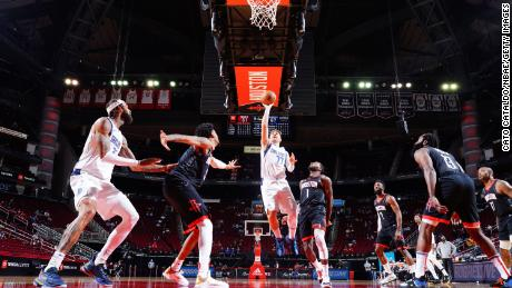 Doncic shoots the ball against the Houston Rockets.