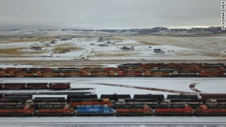 Hundreds of train engines, used to transport coal, are parked in a train yards near Gillette, Wyoming.
