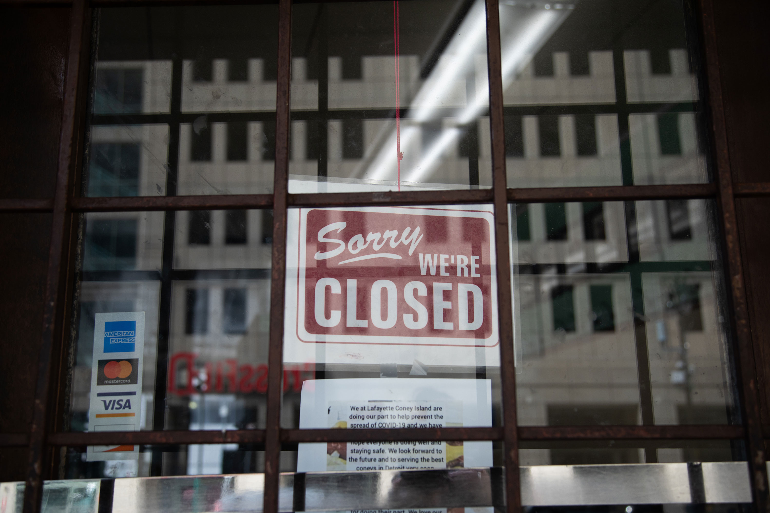"""A """"closed"""" sign hangs on the door of a restaurant in Detroit in April."""