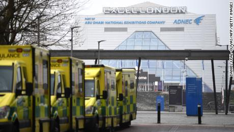 Ambulances are parked outside the NHS Nightingale hospital at the ExCel centre in east London on January 1, 2021.