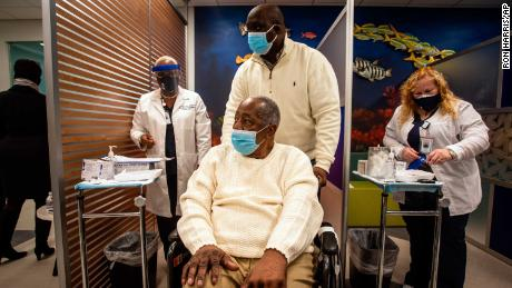 Baseball Hall of Famer Hank Aaron prepares to receive his COVID-19 vaccination on January 5, 2021 in Atlanta.
