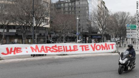 """A protest banner against club president Jacques-Henri Eyraud reads: """"JHE: Marseille vomits you."""""""