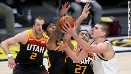Nikola Jokic of the Denver Nuggets goes to the basket against the Utah Jazz.