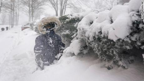 Arturo Diaz, 4, plays in a deep snow bank in Hoboken, New Jersey, on Monday.