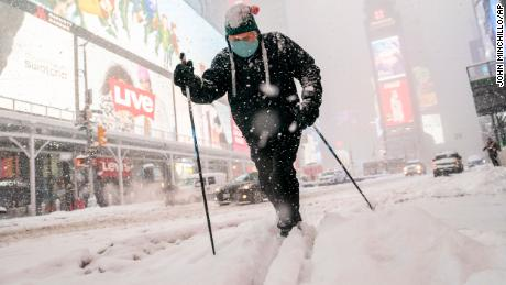 Steve Kent skis through Times Square in New York on Monday.