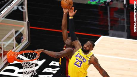 James defends a pass intended for Clint Capela of the Atlanta Hawks.