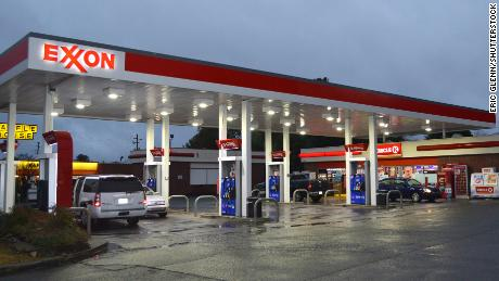 ExxonMobil reports its first annual loss since its merger
