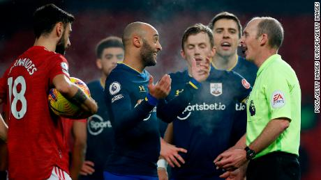 Southampton players remonstrate with referee Mike Dean after their side's second red card.