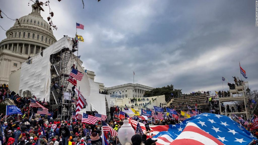 Opinion: I was a member of a cult. Here's how to bring QAnon believers back to reality