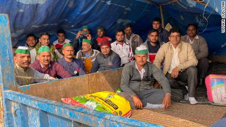 Down time in Ghazipur as farmers gather together outside of a makeshift tent, on February 4, 2021.
