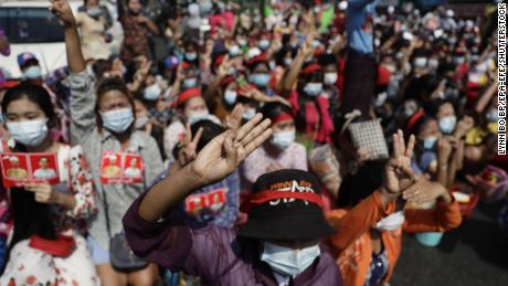Protesters flash the three-finger salute during a demonstration against the military coup in Yangon, Myanmar, February 6.