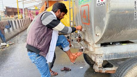 A farmer at the Ghazipur protest camp washes his leg, on February 4, 2021.