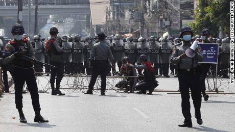 Riot police block a road in Yangon, Myanmar, 06 February 2021.