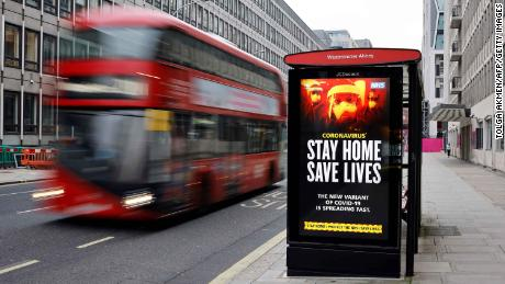 A digital display at a bus station warns pedestrians of the new strain of coronavirus in central London on January 8.