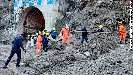 This photograph from the National Disaster Response Force shows NDRF personnel rescuing workers at one of the hydropower projects at Reni village in Chamoli district.