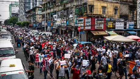 Protesters march through a street on February 8, 2021 in Yangon, Myanmar.