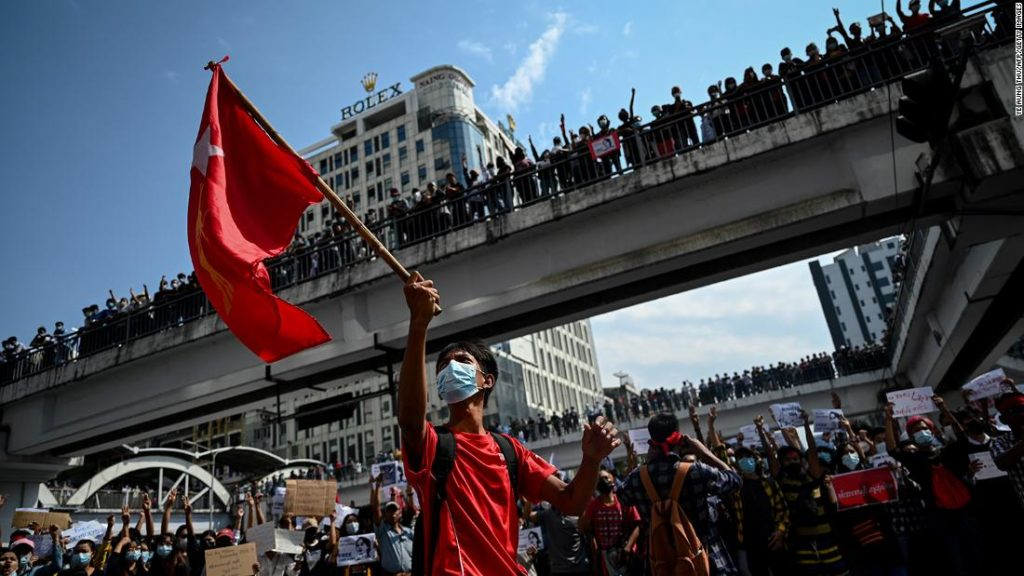 Myanmar military warns protesters not to destroy democracy as protests grow