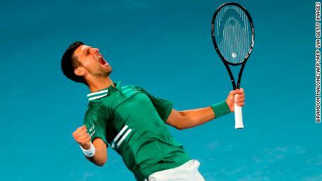 Djokovic lets out a celebratory roar as he defeats Fritz.