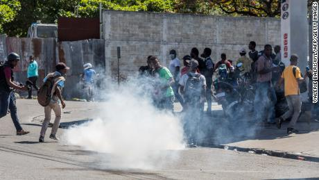 Police fire tear gas during a march in Port-au-Prince on February 10, 2021, to protest against the government of President Jovenel Moise.