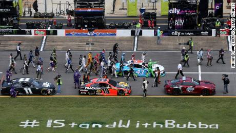NASCAR drivers push the #43 Victory Junction Chevrolet, driven by Bubba Wallace, to the front of the grid as a sign of solidarity with the driver prior to the NASCAR Cup Series GEICO 500 at Talladega Superspeedway on June 22, 2020 in Talladega, Alabama.