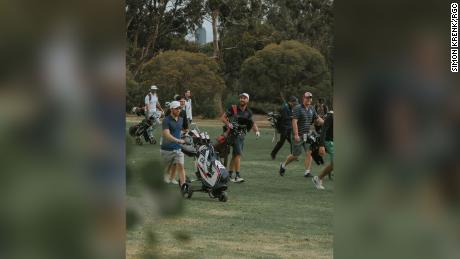 Players walk down the fairway during a round between Random Golf Club fans.