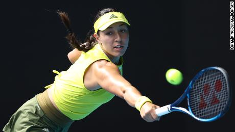 Pegula plays a backhand in her match against Svitolina.