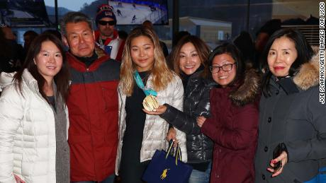 U.S. Olympian Chloe Kim poses for a photo with her family at the USA House in PyeongChang.