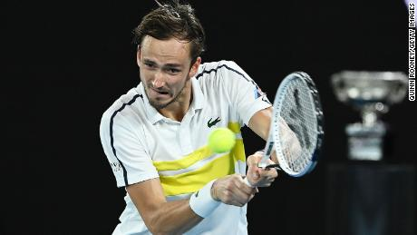 Medvedev plays a backhand in his match against Tsitsipas.