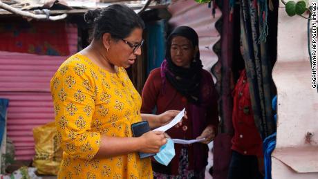 Activist Rachna Dhingra talks to a resident of Oriya Basti slum in Bhopal on January 8, 2021.