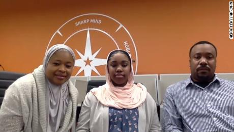 Najah Aqeel, center, and her parents.