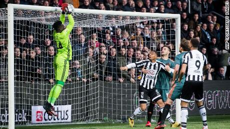 Onana catches the ball durng a match against Heracles Almelo.